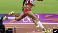 Allyson Felix crosses the finish line to win gold.