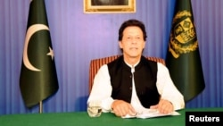 FILE - Pakistan's Prime Minister Imran Khan speaks to the nation in his first televised address in Islamabad, Pakistan, Aug. 19, 2018.