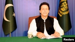 Pakistan's Prime Minister Imran Khan speaks to the nation in his first televised address in Islamabad, Pakistan, Aug. 19, 2018.