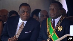 FILE: Zimbabwean President Emmerson Mnangagwa right, sits with his Deputy Constantino Chiwenga during a Heroes' Day event to commemorate the lives of those who died in the southern African country's 1970s war against white minority rule, in Harare.