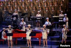 FILE PHOTO: The Moranbong Band, an all-female North Korean pop band formed by leader Kim Jong Un, performs at a celebratory concert marking the end of the 7th Workers' Party Congress in Pyongyang, North Korea May 11, 2016.