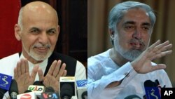 FILE - Afghan presidential candidate Ashraf Ghani (left) at press conference on July 5, 2014. Rival presidential candidate Abdullah Abdullah at a press conference at his residence on July 6, 2014.