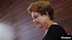 FILE - Brazil President Dilma Rousseff arrives to speak to members of the media during a visit at Google headquarters in Mountain View, California, July 1, 2015.