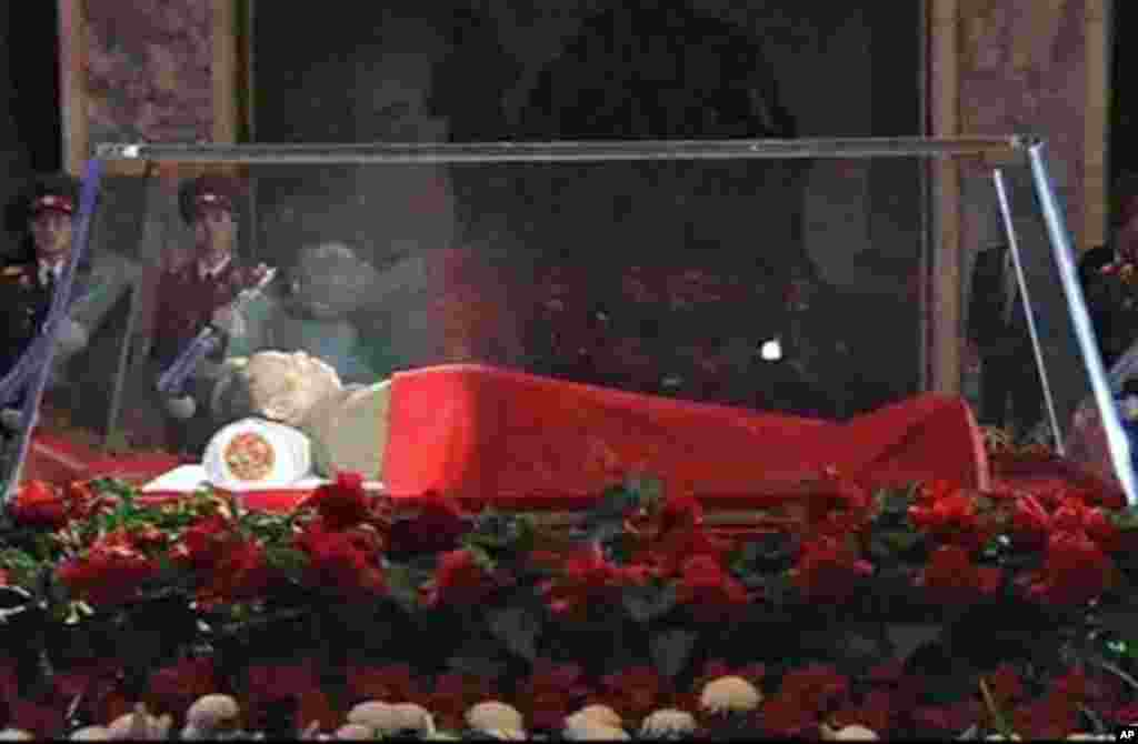 North Korean leader Kim Jong Il lies in state in a memorial palace in Pyongyang, North Korea, as his youngest known son and successor, Kim Jong Un visited. December 20, 2011. (AP)