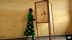FILE - A voter walks toward a voting booth in Bujumbura, Burundi, as people prepared to vote in a presidential election.