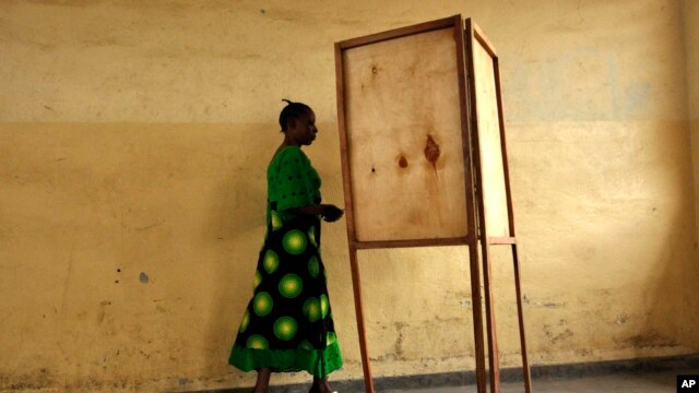 FILE - A  woman walking towards a voting booth in Bujumbura, Burundi, as people prepared to vote in a presidential election, June 28, 2010.