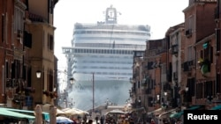 FILE - The MSC Divina cruise ship is seen in Venice lagoon, June 16, 2012.
