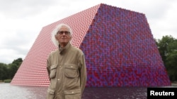 Artist Christo stands in front of his work The London Mastaba, on the Serpentine in Hyde Park, London, Britain, June 18, 2018.