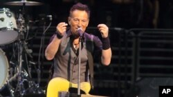 """FILE - Legendary rocker Bruce Springsteen performs in concert with the E Street Band during """"The River Tour 2016"""" in Philadelphia, Pennsylvania, Feb. 12, 2016."""