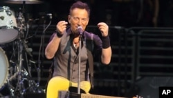 "FILE - Bruce Springsteen performs in concert with his E Street Band during ""The River Tour 2016"" in Philadelphia, Pennsylvania, Feb. 12, 2016."