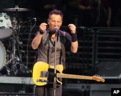 """FILE - Bruce Springsteen performs in concert with the E Street Band during """"The River Tour 2016"""" in Philadelphia, Feb. 12, 2016. Springsteen has canceled his concert in North Carolina, citing the state's new law blocking anti-discrimination rules as the reason."""