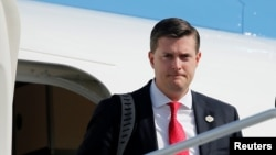 FILE - White House Staff Secretary Rob Porter arrives aboard Air Force One in Morristown, New Jersey, Aug. 4, 2017.