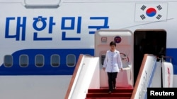 South Korean President Park Geun-hye arrives at the airport in Beijing, June 27, 2013.