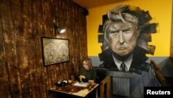 A visitor has a meal at Trump Burger, a new Russian diner named after U.S. President Donald Trump, in Krasnoyarsk, Russia July 17, 2018. (REUTERS/Ilya Naymushin)