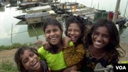 Bangladeshi girls smile at Savar village, on the outskirts of Dhaka, Bangladesh.