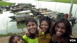 Bangladeshi children smile at Savar village, on the outskirts of Dhaka, Bangladesh, Friday, Sept. 30, 2005. Bangladesh observed National Girl Child Day Friday. (AP Photo/Pavel Rahman)