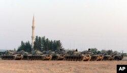 Turkish tanks stationed near the Syrian border, in Karkamis, Turkey, Aug. 27, 2016.