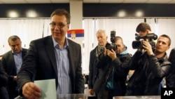 Serbian Progressive Party leader Aleksandar Vucic casts his ballot at a polling station in Belgrade, Serbia, March 16, 2014.
