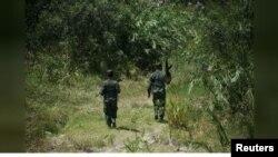 Imagen de archivo de soldados venezolanos patrullando cerca de la frontera con Colombia en el estado de Táchira, en Venezuela, el 20 de agosto de 2015.