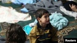 Dečak koji je preživeo napad hemijskim oružjem