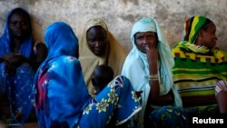 Internally displaced women from Bangui attend a community meeting in Bambari, Central Africa Republic, June 16, 2014.