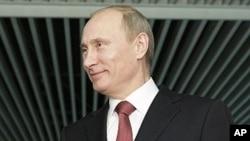 Russian Prime Minister Vladimir Putin gestures while speaking to journalists in Moscow, April 13, 2011
