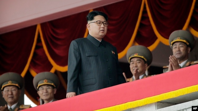 FILE - North Korean leader Kim Jong Un watches parade participants from a balcony at the Kim Il Sung Square in Pyongyang, North Korea, May 10, 2016.