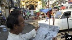 A trishaw man reads a newspaper reporting elections as he awaits passengers on Monday, Nov. 8, 2010, in Yangon, Myanmar. Myanmar's secretive military-ruled government gave no sign Monday of when results from the country's first election in two decades wou