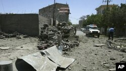 A general view shows the scene after suicide blasts near an Italian-run compound in Herat, May 30, 2011