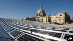 FILE - A photo shows solar panels on the roof of the Paul VI Hall, at the Vatican.