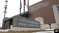FILE - The entrance to the Ferguson, Mo., Police Department.