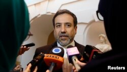 FILE - Iran's top nuclear negotiator Abbas Araqchi talks to journalists after meeting senior officials from the United States, Russia, China, Britain, Germany and France in Vienna, Austria, Oct. 19, 2015.