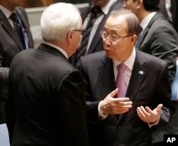 U.N. Secretary-General Ban Ki-moon, right, talks with Vitaly Churkin, Russia's U.N. ambassador, before a Security Council meeting at U.N. headquarters, Sept. 30, 2015.