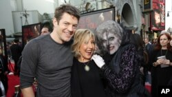 "Producer Jason Blum, Lin Shaye and The Black Bride seen at Gramercy Pictures presents the world premiere of ""Insidious: Chapter 3"" held at TCL Chinese Theatre on Thursday, June 4, 2015, in Hollywood. (Photo by Eric Charbonneau/Invision for Focus Features/AP Images)"
