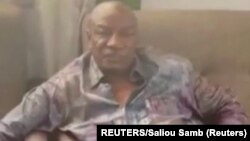 Guinea, Conakry, A screen grab from a video shared on social media, but not yet authenticated, claimed to show Guinea's President Alpha Conde detained by army special forces