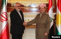 FILE - Iraqi Kurdish regional President Masoud Barzani, right, shakes hands with Iranian Foreign Minister Mohammad Javad Zarif in Irbil, Aug. 26, 2014.