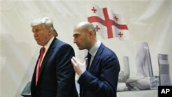 Real estate developer Donald Trump, left, and George Ramishvili, Chairman of Silk Road Group, talk following a news conference in New York, March 10, 2011