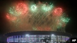 Fireworks explode over the Gelora Bung Karno Stadium during the closing ceremony for the 18th Asian Games at in Jakarta, Indonesia, Sunday, Sept. 2, 2018.