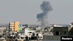 Smoke is seen after what witnesses said was an Israeli airstrike in Gaza City, Aug. 19, 2014.