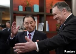 U.S. Secretary of State Mike Pompeo escorts Kim Yong Chol, North Korea's lead negotiator in nuclear diplomacy with the United States, into talks at a hotel in Washington, Jan. 18, 2019.