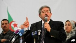 FILE - Then-Prime Minister Ahmed Ouyahia speaks during a meeting of the National Rally for Democracy in Algiers, May 5, 2012.
