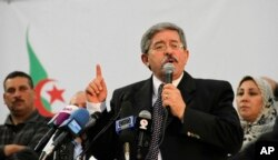 FILE - Algerian Prime Minister Ahmed Ouyahia speaks during a meeting of the National Rally for Democracy in Algiers.