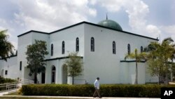 FILE - A man is seen walking past a mosque in Margate, Florida, in a May 14, 2011, photo.