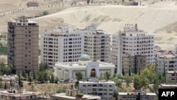 FILE - New buildings are seen in Damascus, where the price of property has been rising sharply.