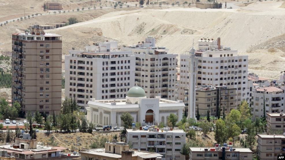 Alcuni dei nuovi edifici costruiti a Damasco e venduti agli iraniani. Credits to: Louai Beshara/AFP