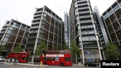 FILE - Luxury apartment complex One Hyde Park is seen London, May 2, 2014. Anti-corruption campaigners see it as a landmark to what they see as Britain's hypocritical role in offshore finance.
