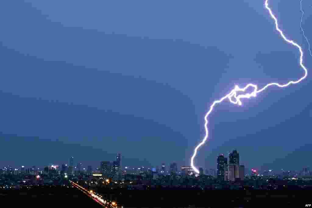 A lightning strikes over the Hanoi skyline, Vietnam.
