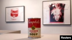 "Andy Warhol's ""Campbell's Chicken with Rice Soup,"" tin soup can filled with concrete, has a pre-auction estimate of $50,000-$70,000, on display at Christie's, New York City, Feb. 22, 2013."
