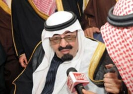Saudi Arabia's King Abdullah speaks to Saudi media upon his arrival at Riyadh airport, February 23, 2011