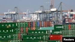 FILE - Cargo containers are seen sitting idle at the Port of Los Angeles, California, February 18, 2015.